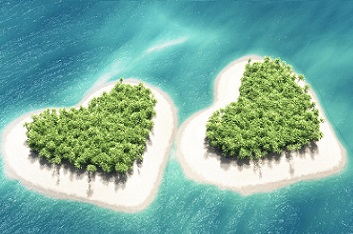 Airplane above the second heart-shaped tropical island